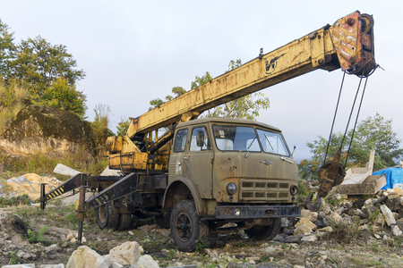 Old Soviet production car MAZ with yellow crane