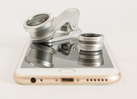 Fisheye macro set for mobile phone white background Stock Photo