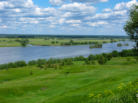 Valley of the Oka River near Konstantinovo with bright cloudy sky on summer day