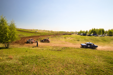 Sekiotovo, Ryazan, Russia - may 9, 2016: Autocross Russian Cup Championship stage, Spectators watch, drivers ride cars on road