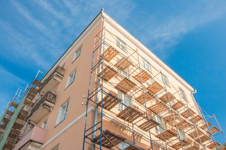 Scaffolding near the building bright sunny day blue sky.
