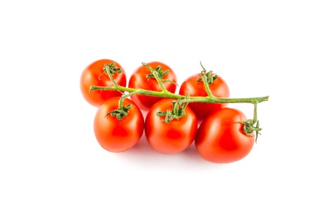Cherry tomatoes isolated over white background close Stock Photo