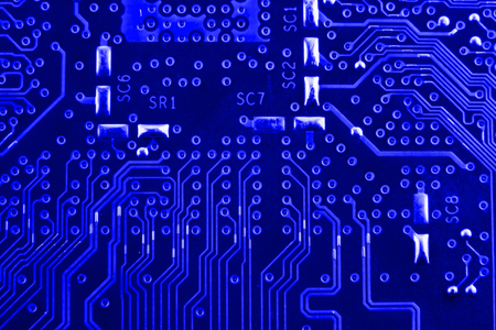 Conductive tracks on the motherboard of Printed Circuit Board close macro.