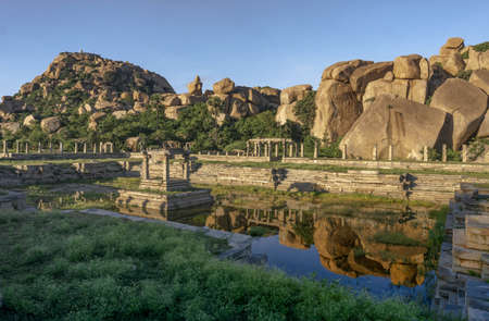 pool with stone steps in Hampi, an ancient temple reservoir