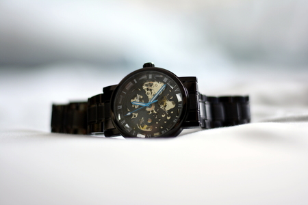 close-up of mechanical wristwatch on white background