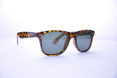 a7ec54372 Leopard-rimmed sunglasses with dark glasses on a white background, isolated.