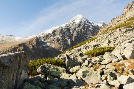 lithic: Spiky peaks of the mountain range on a summer day Stock Photo