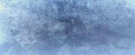 Elegant sapphire blue background with white hazy top border and dark black grunge texture bottom border, luxury blue design 版權商用圖片