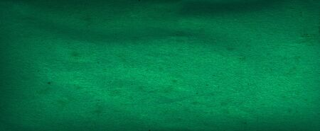 Green cement surface texture with shiny spotlight background