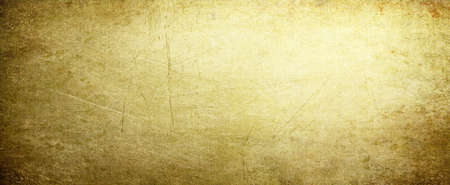 Gold background with vintage texture, yellow background with brown border, old yellow paper or parchment.