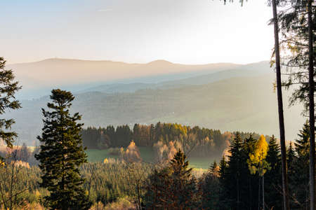 Landscape misty panorama. Fantastic dreamy sunrise on rocky mountains with view into misty valley below. Foggy clouds above forrest. View below to fairy landscape. Foggy forest hills. Stok Fotoğraf