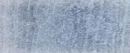 Elegant sapphire blue background with white hazy top border and dark black grunge texture bottom border, luxury blue design Imagens