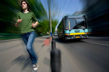 vying: Girl runs on pathway alongside a bus.