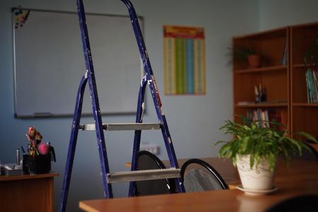 ladder inside the classroom Фото со стока