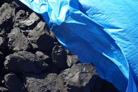 black coal with blue tent