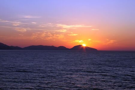 colorful sunrise over sea photo