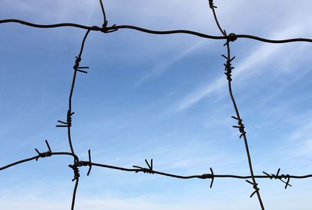 sky of freedom behind barbed wire Stock Photo - 7949942