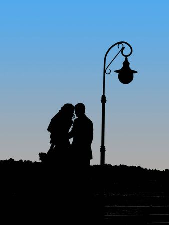 quay: silhouettes of newly-weds near a lantern on a quay                         Stock Photo