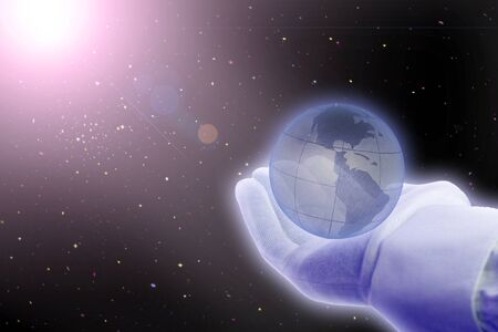 universe: hand holding globe over space with shining sun photo