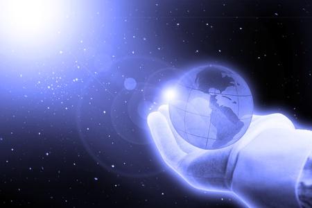 照らす: 生命: 空間上に置くとグローブ手袋で手
