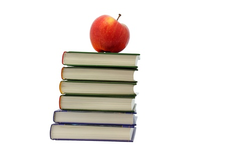 red apple on pile of books over white photo