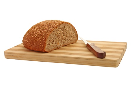 half stuff: bran bread with knife on cutting board