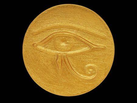 golden color amulet Eye of Horus isolated on black                                photo