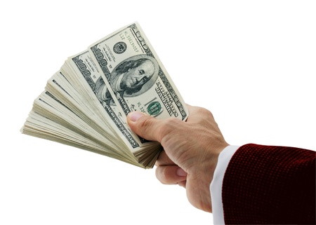 giving money: hand of businessman holding fan-shaped dollars