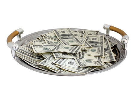 round tray with heap of dollars photo