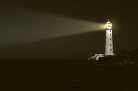 lighthouse at night: beam of light over sea photo