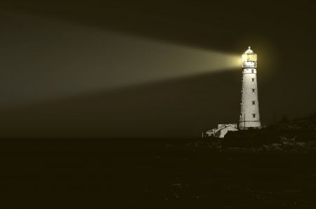 lighthouse at night: beam of light over sea Stock Photo