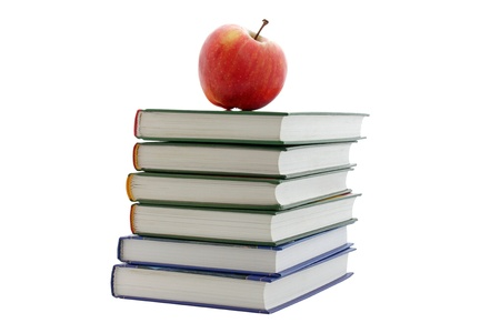 apple on pile of books isolated on white photo