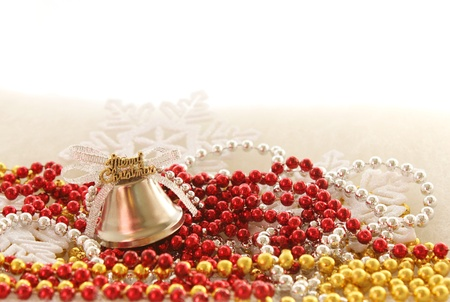 christmas tree decorations: merry christmas bell on beads photo