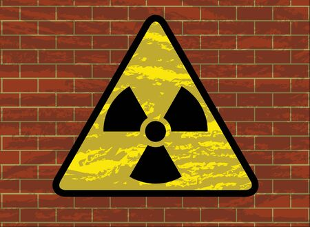 radioactivity trefoil sign on grunge brick wall vector illustration Vector