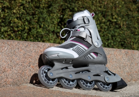 cuff buckle: skate with brake on a road in park