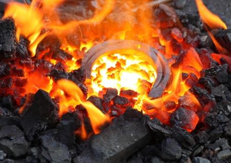 embers: horseshoe in embers in forge