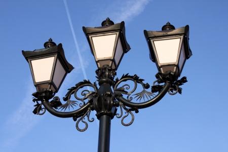 triple vintage street lamp over blue sky Stock Photo - 16002188