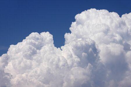 rain clouds in a blue sky