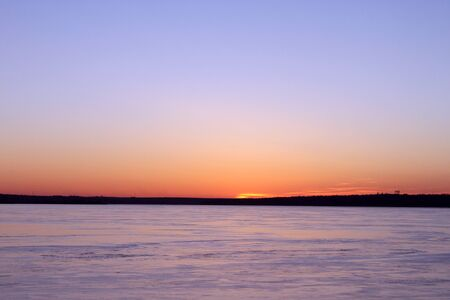 frozen river: sunset over frozen river