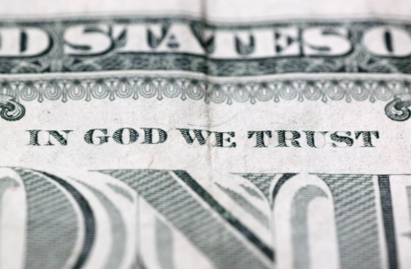 close up of In God we trust motto on 100 dollars photo