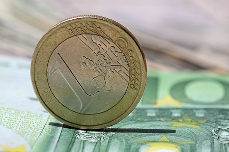 one hundred euro banknote: one euro coin on one hundred  euro banknote