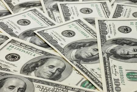 one hundred dollars: one hundred dollars banknotes background Stock Photo