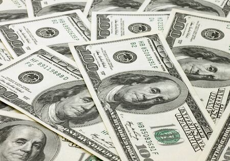 one hundred dollars: close up of one hundred dollars banknotes