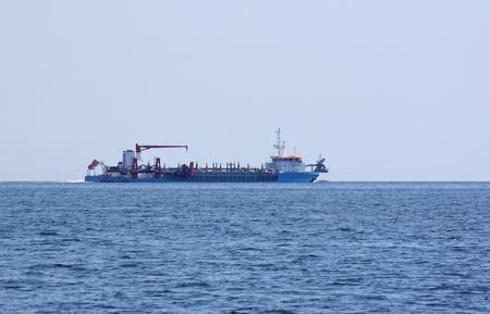 dredger: view on dredger in sea
