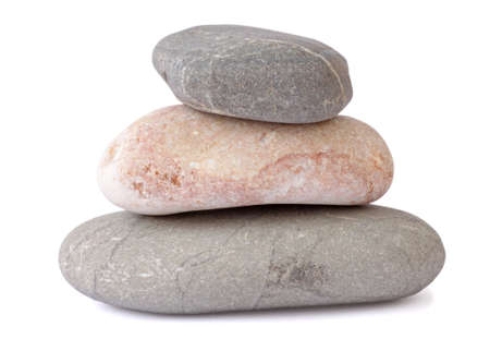 pile of three stones over white