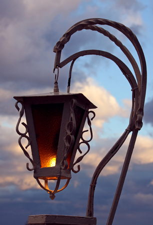 alight lantern over cloudy sky photo