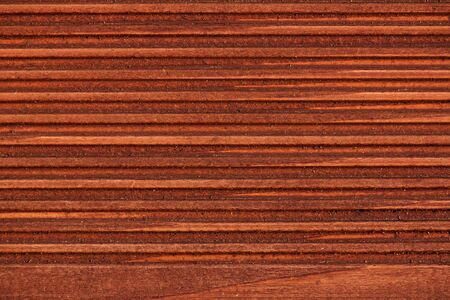 close up of grooved wooden board photo