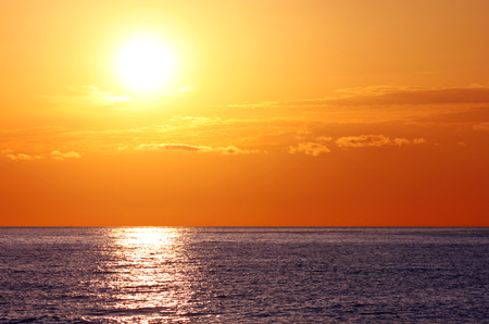 picturesque sunrise in sea photo
