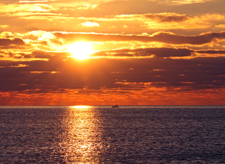 sunrise in sea photo