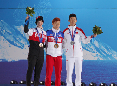 SOCHI, RUSSIA - FEBRUARY 22, 2014  Cournoyer  CAN , Victor An  RUS  and Dajing Wu  CHN  during short track speed skating men s 500m medal ceremony at Sochi 2014 XXII Olympic Winter Games